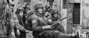 The determined John Wayne (Lt. Col. Vandervoort) hobbled through D-Day on a broken ankle, using a rifle as a crutch.